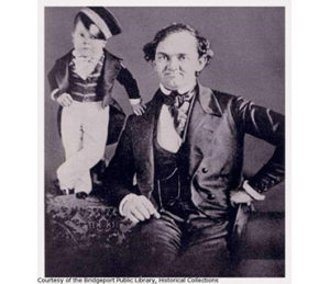 Two circus performers, a man with an infant sized man standing near him, courtesy of the Bridgeport Public Library Historical Collections