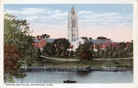 An old postcard showing the Perkins Center, which is a tall building on a riverfront
