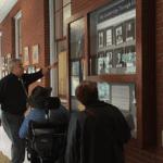 Photo of people looking at hallway display