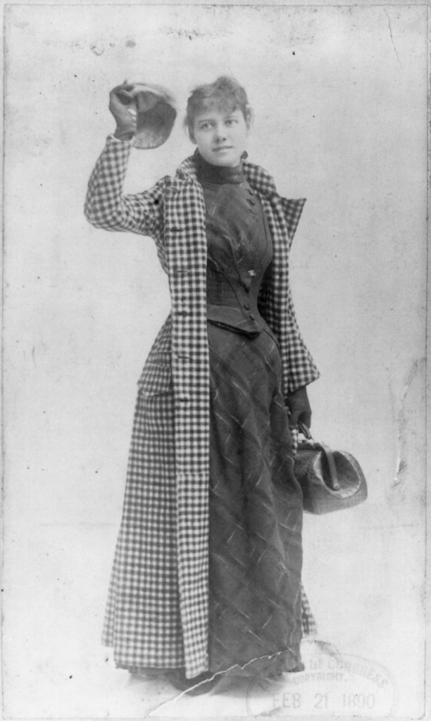 Nellie Bly posing for a publicity shot for The World, wearing her travelling gown and holding her handbag, Feb. 21, 1890. Courtesy of the Library of Congress.